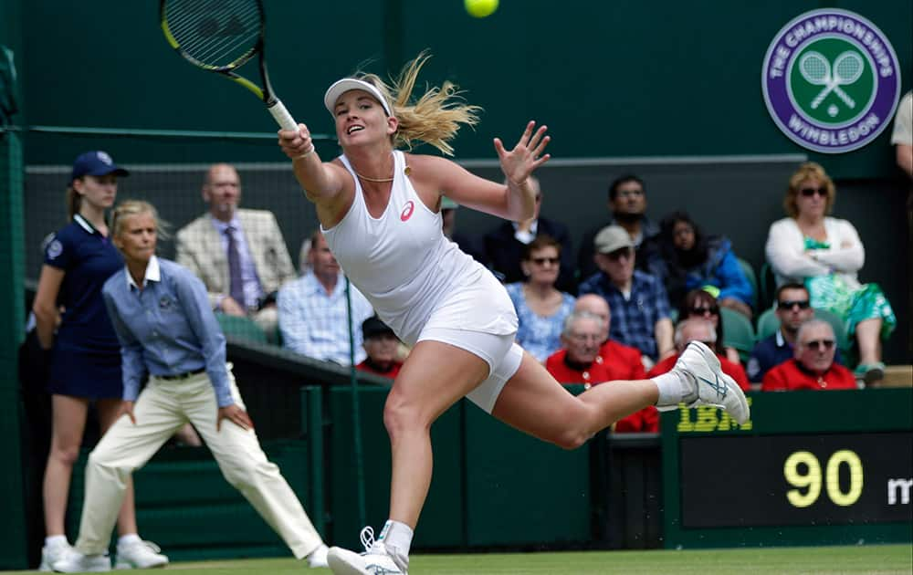 Coco Vandeweghe of the United States returns a ball to Maria Sharapova of Russia, during their singles match at the All England Lawn Tennis Championships in Wimbledon, London.
