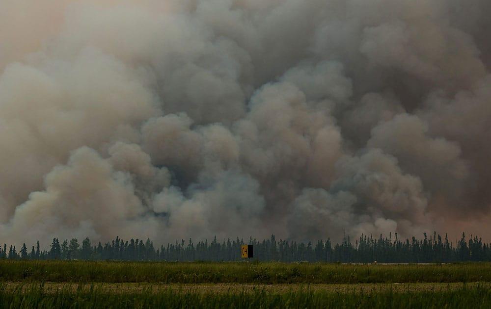 smoke billows from a wildfire near La Ronge, Saskatchewan.