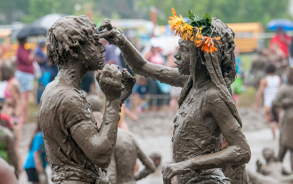 Caprise Debose and Kaliyah Watson, of Westland, play together during the annual Mud Day at Nankin Mills Park in Westland, Mich.