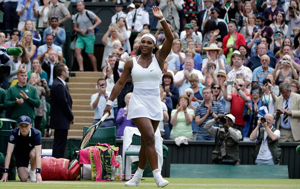 Serena Williams of the United States celebrates winning the singles match against Victoria Azarenka of Belarus, at the All England Lawn Tennis Championships in Wimbledon, London.