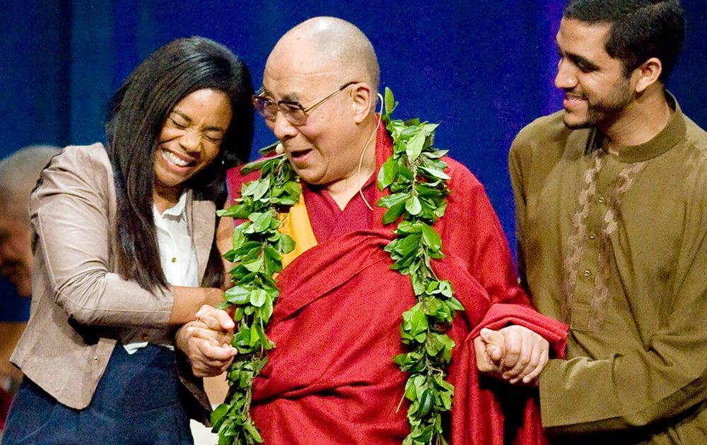 Actress Regina King, shares a laugh with the Dalai Lama after she remarked how handsome he is during his three day 80th Birthday and Global Compassion Summit at the University of California, Irvine, in Irvine, Calif.