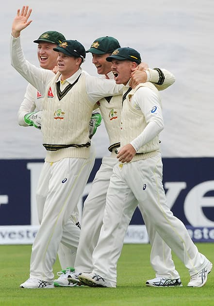 Australia's Brad Haddin, Steve Smith, Michael Clarke and David Warner, celebrates the wicket of England's Adam Lyth during day one of the first Ashes Test cricket match, in Cardiff, Wales.
