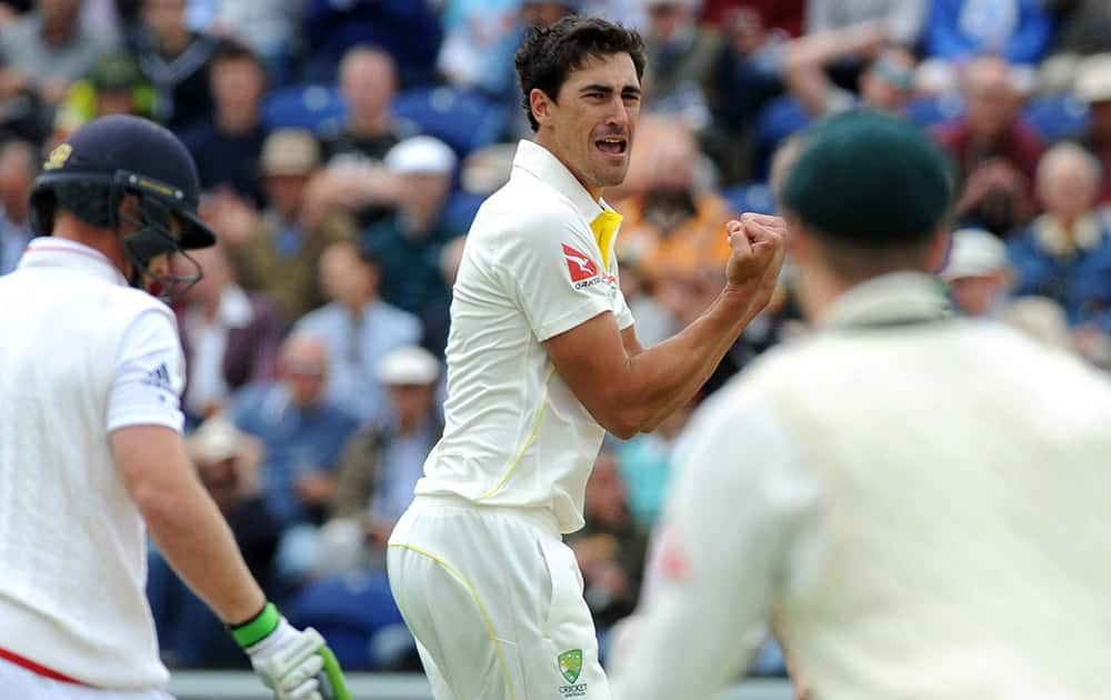 Australia's Mitchell Starc celebrates after getting England's Ian Bell LBW for one run during day one of the first Ashes Test cricket match, in Cardiff, Wales.