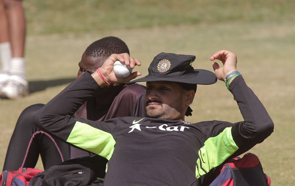 Harbhajan Singh relaxes after a practice session in Harare, Zimbabwe.