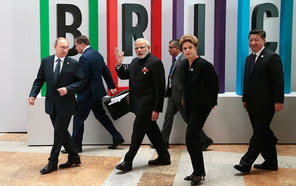 Russian President Vladimir Putin, Indian Prime Minister Narendra Modi, Brazilian President Dilma Rousseff, Chinese President Xi Jinping walk for a plenary session during the summit in Ufa, Russia.