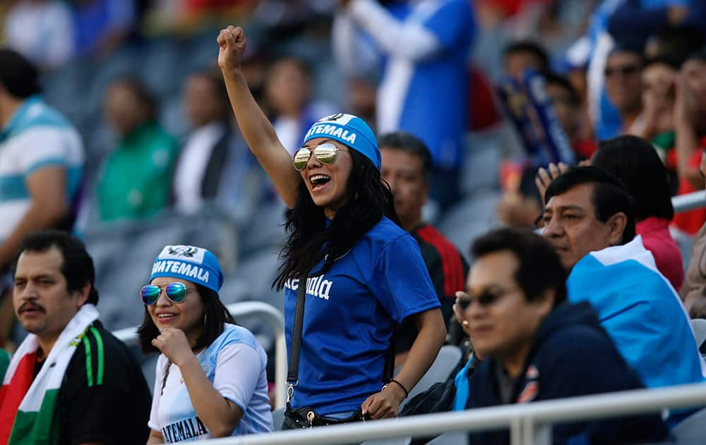 Guatemala fans cheer during the first half of the team's CONCACAF Gold Cup soccer match against Trinidad and Tobago.