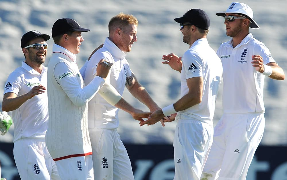 England's Ben Stokes, celebrates with James Anderson, after Australia's Adam Voges was bowled by Ben Stokes caught James Anderson for 31 runs during day two of the first Ashes Test cricket match, in Cardiff, Wales.
