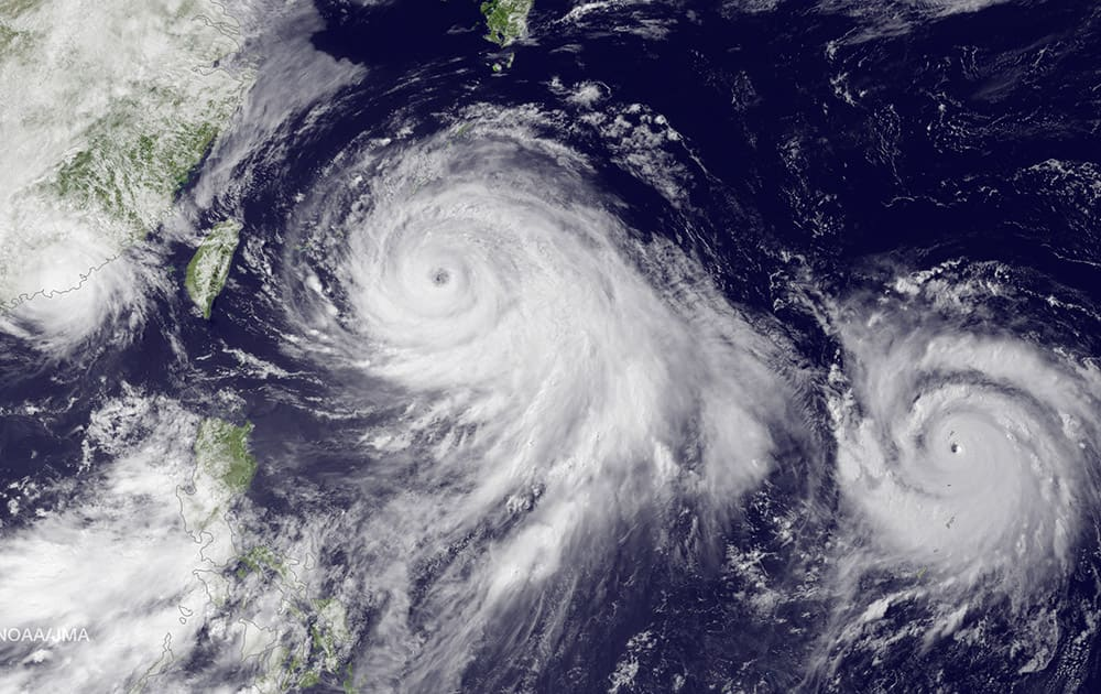 This satellite image taken by the JMA MTSAT-2 satellite at 9;30 a.m. EDT, shows Tropical Storm Linfa, left, tracking westward parallel to the coast of China, and Typhoon Chan-hom, over the Ryukyu Trench south of Okinawa, Japan, on a track heading northwest toward the China coast north of Wenzhou.