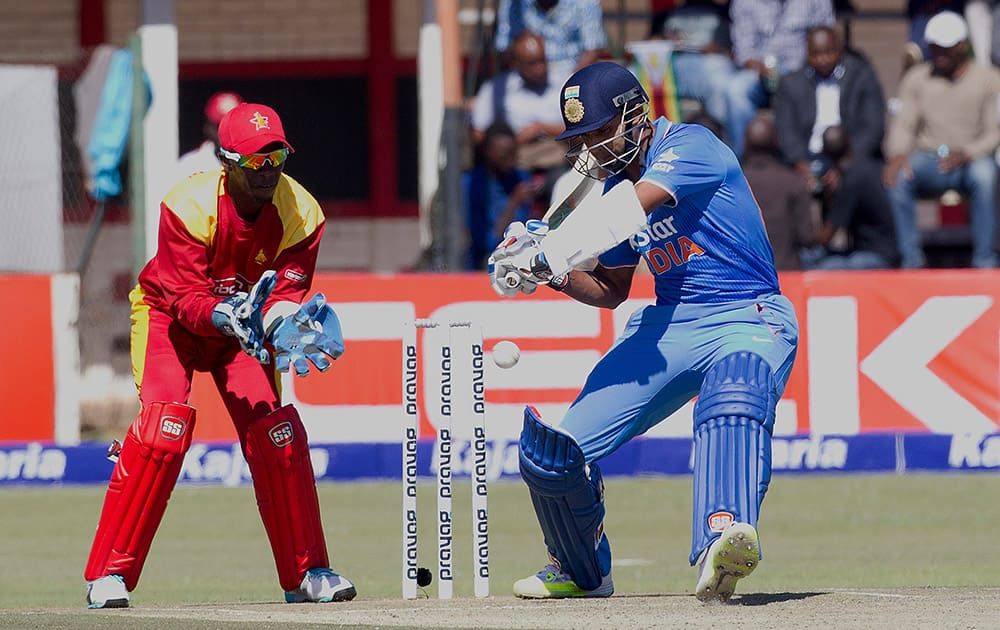 Stuart Binny plays a shot while Zimbabwean wicketkeeper Richmond Mutumbami looks onduring the first One Day International against Zimbabwe in Harare.
