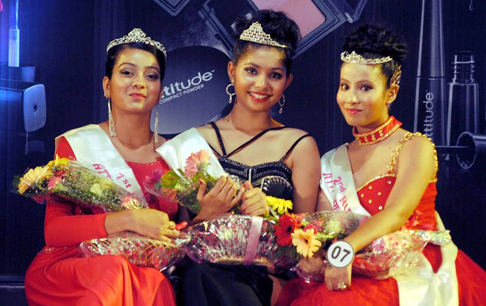 Winner Archna Sharma (middle), 1st runner up Riha Chakraborty (Right) and 2nd runner up Dhrupadi Das (Left) posing for a photographer after winning the Attitude Fashion Show 2015 at Shankardev Kalakhetra in Guwahati.