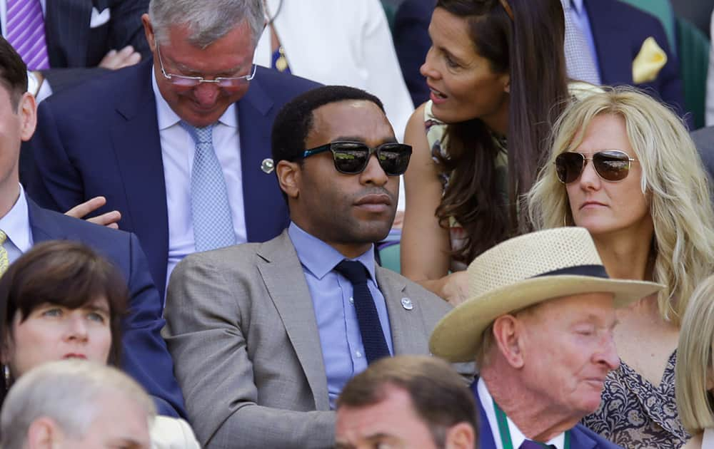 British actor Chiwetel Ejiofor sits in the Royal Box, on Centre Court, ahead of the men's singles semifinal matches, at the All England Lawn Tennis Championships in Wimbledon, London.