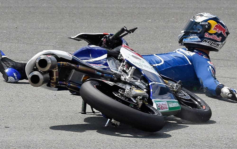 Honda rider Enea Bastianini of Italy crashes during the Moto3 free practice at the Sachsenring circuit in Hohenstein-Ernstthal, Germany.