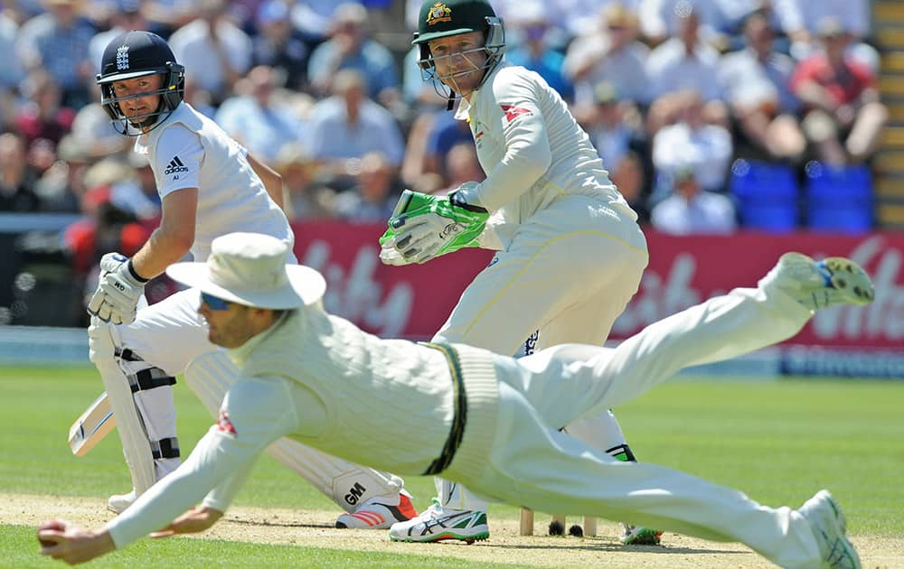 England's Adam Lyth is caught by Michael Clarke for 37 runs off the bowling Australia's Nathan Lyon during day three of the first Ashes Test cricket match, in Cardiff, Wales.