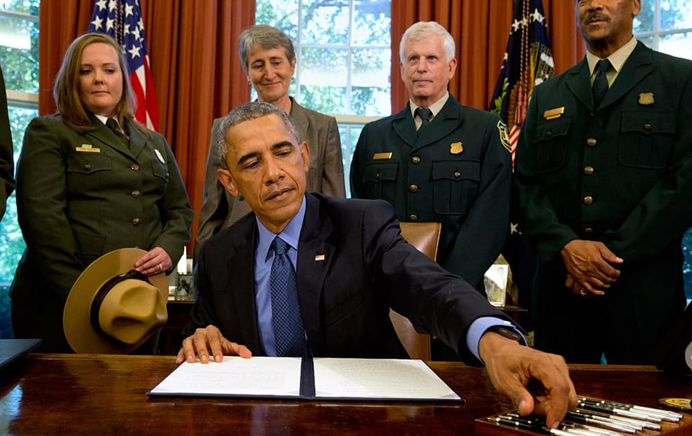President Barack Obama, signs designations for three new national monuments; Berryessa Snow Mountain in California, Waco Mammoth in Texas, and the Basin and Range in Nevada, in the Oval Office of the White House.