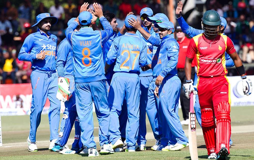 Players celebrate after dismissing Zimbabwean batsman Chamunorwa Chibhabha, during the One Day International against Zimbabwe in Harare, Zimbabwe.