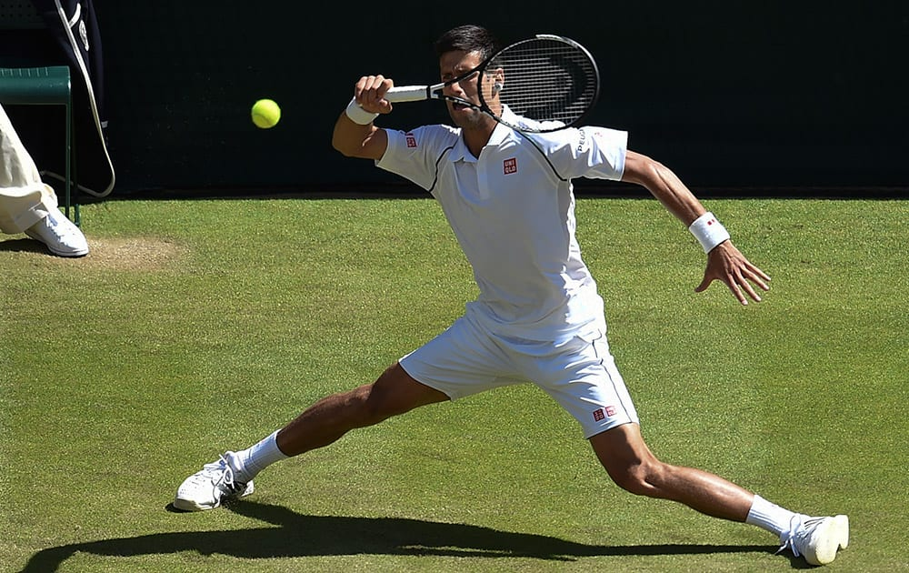 Novak Djokovic of Serbia returns a shot to Richard Gasquet of France during their men's singles semifinal match at the All England Lawn Tennis Championships in Wimbledon.