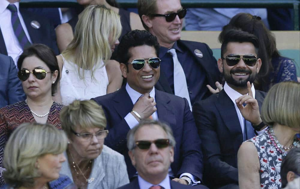 SACHIN TENDULKAR SITS IN THE ROYAL BOX ON CENTRE COURT, AT THE ALL ENGLAND LAWN TENNIS CHAMPIONSHIPS IN WIMBLEDON.