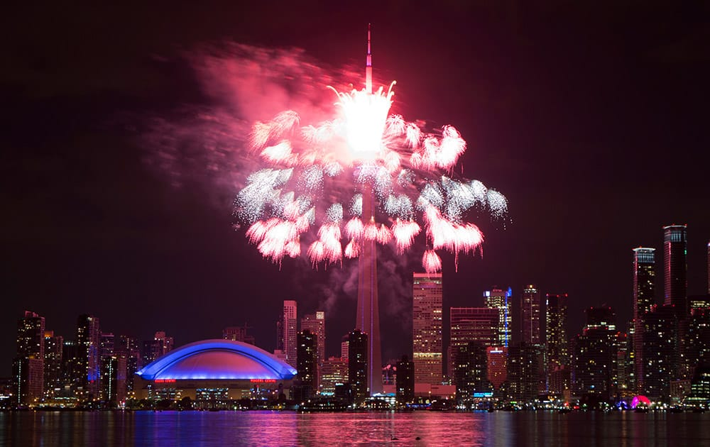 Fireworks explode off the CN Tower in downtown Toronto, during the opening ceremonies for the Pan Am Games.
