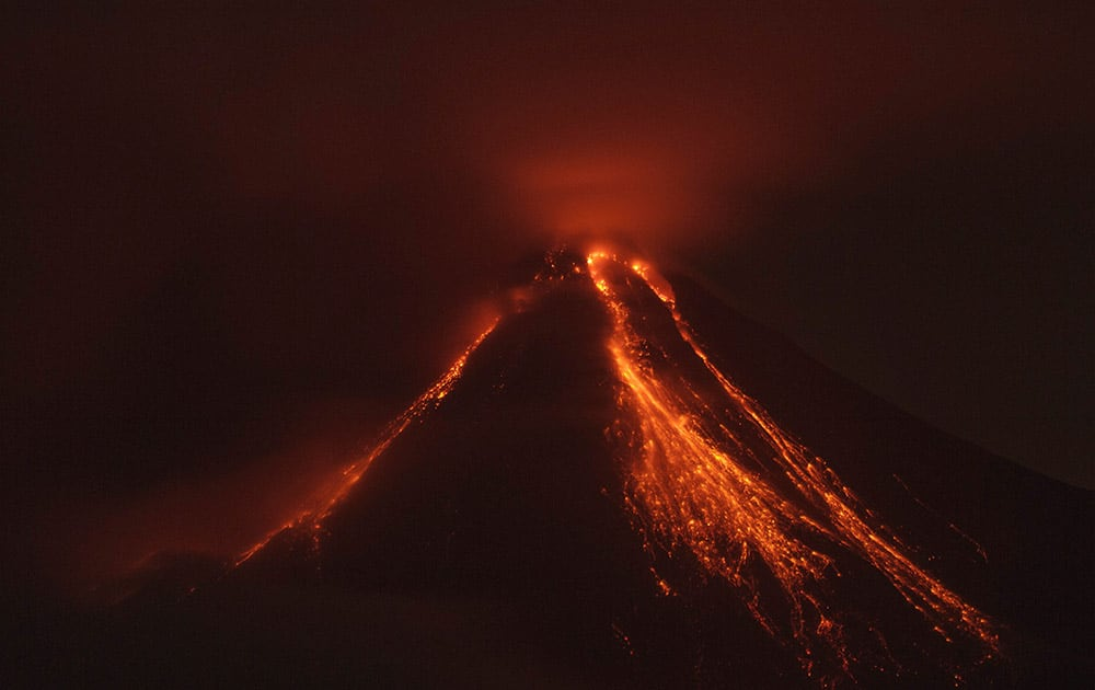 Lava flows down the banks of the Colima Volcano, also known as the Volcano of Fire, near the town of Comala, Mexico.