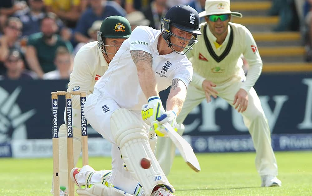 England's Ben Stokes plays a shot during day three of the first Ashes Test cricket match, in Cardiff, Wales.