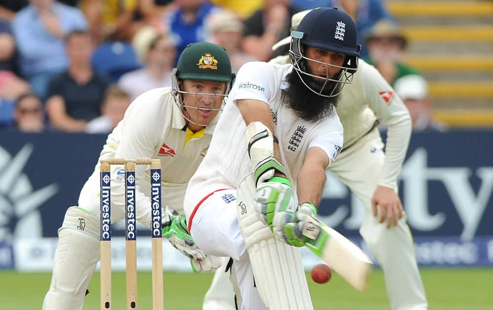 England's Moeen Ali plays a shot during day three of the first Ashes Test cricket match, in Cardiff, Wales.