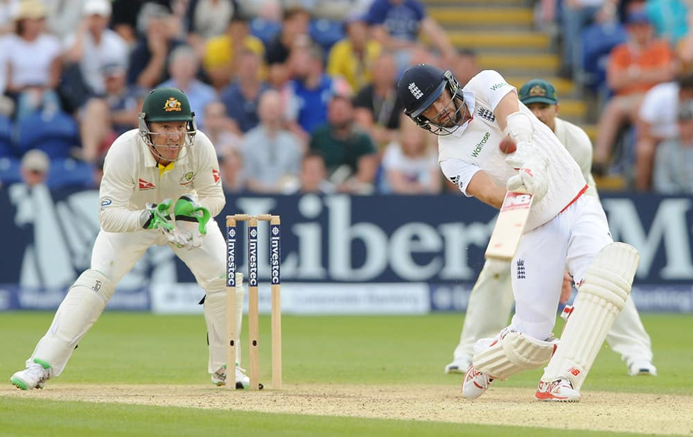 England's Mark Wood hits a six of Australia's Nathan Lyon bowling during day three of the first Ashes Test cricket match, in Cardiff, Wales.