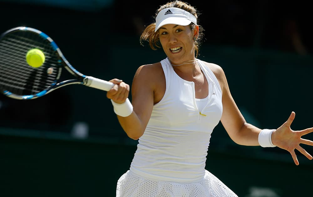 Garbine Muguruza of Spain returns a shot to Serena Williams of the United States during the women's singles final at the All England Lawn Tennis Championships in Wimbledon, London.