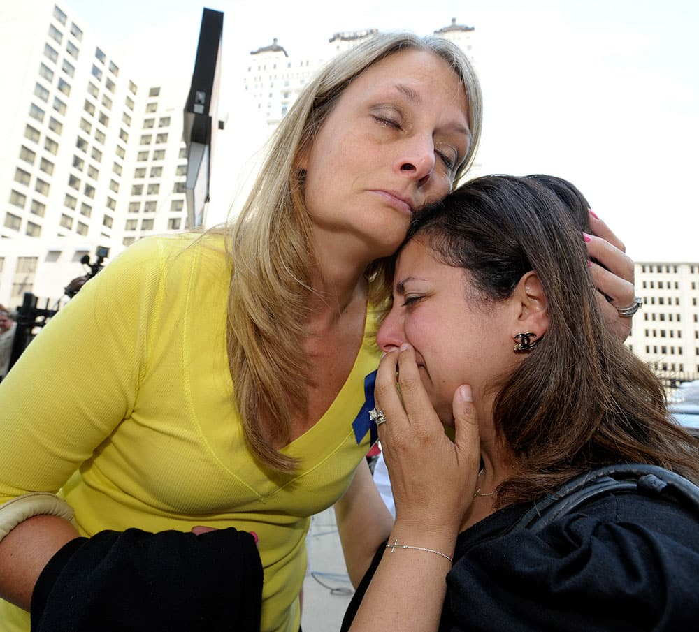 Cheryl Blades, left, of Waterford, hugs a lady who asked not to be identified after the sentencing. The lady was treated by Fata while she was pregnant twice and is still treated for an unknown condition. Thus far, her children are healthy.