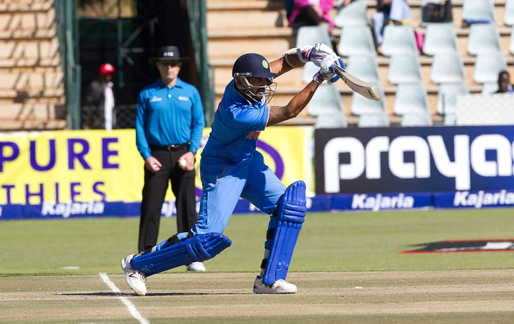 Indian batsman Murali Vijay drives a shot in the second one-day international cricket match against Zimbabwe in Harare, Zimbabwe.