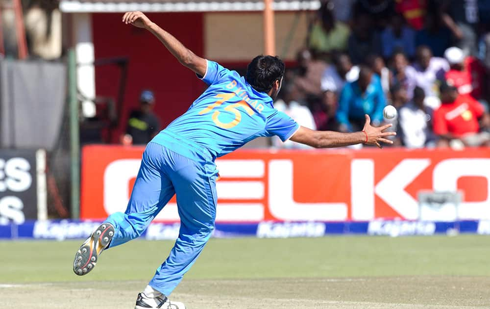 Indian bowler Bhuvneshwar Kumar reaches to stop the ball, during the second One Day International cricket match against Zimbabwe in Harare, Zimbabwe.