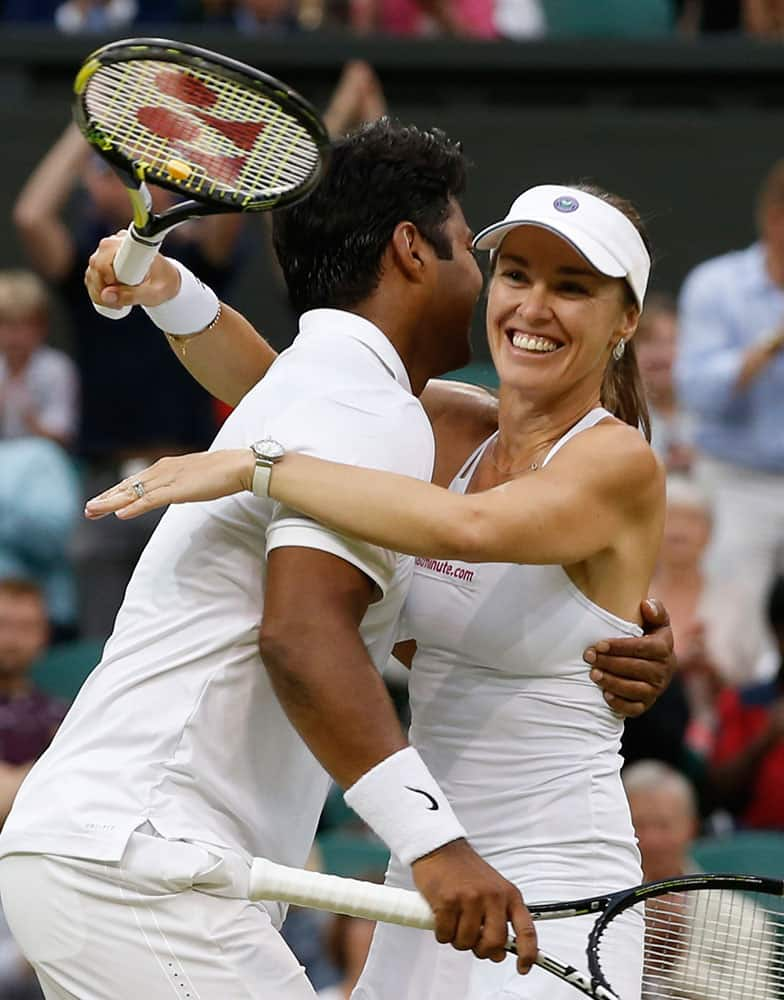 Leander Paes of India, left, and Martina Hingis of Switzerland celebrate winning the mixed doubles final against Alexander Peya of Austria and Timea Babos of Hungary at the All England Lawn Tennis Championships in Wimbledon, London.