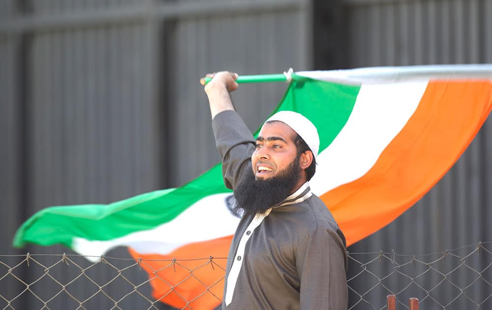 An Indian cricket fan waves the Indian flag on the second One Day International cricket match between India and Zimbabwe in Harare, Zimbabwe.
