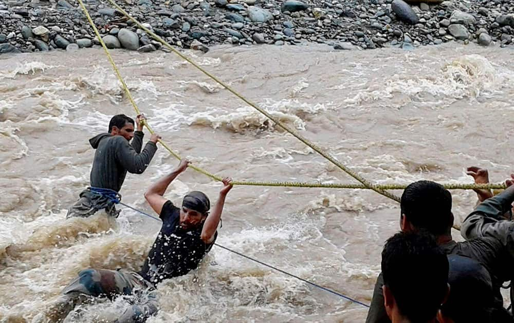 Army rescue people from the flood hit area at Kulgam district of south Kashmir.