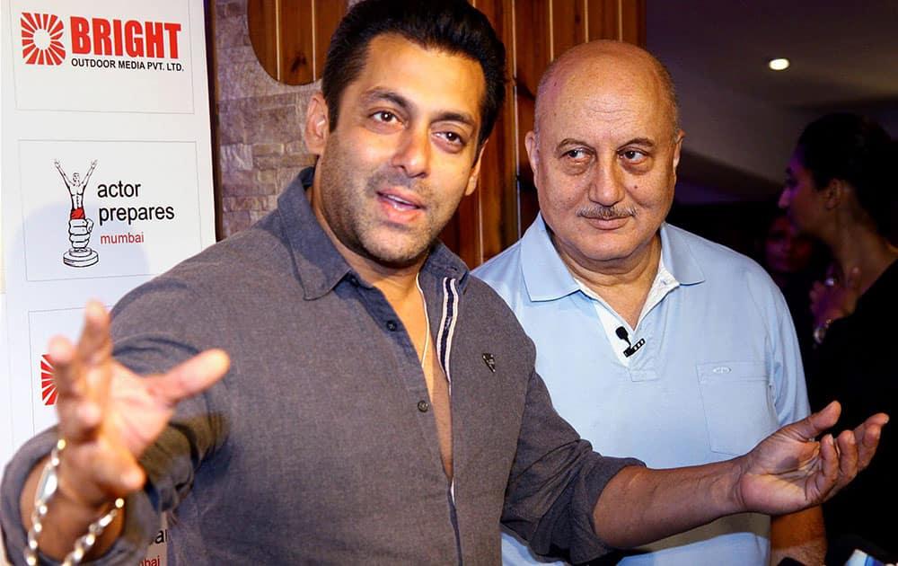Bollywood actor Anupam Kher with Salman Khan during staging of his play Mera Woh Matlab Nahi Tha in Mumbai.
