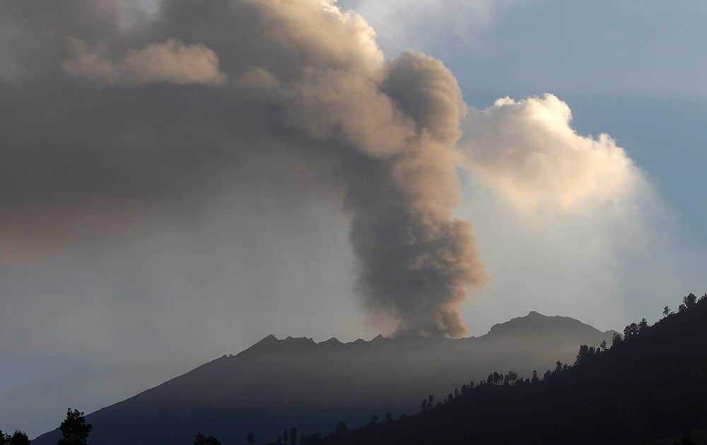 Mount Raung spews volcanic materials into the air as seen from Melaten, East Java, Indonesia.