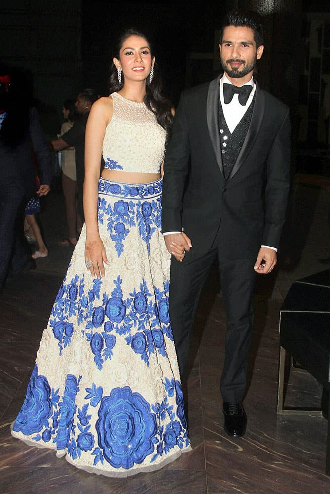 Bollywood actor Shahid Kapoor with his wife Mira Rajput during their wedding reception in Mumbai.