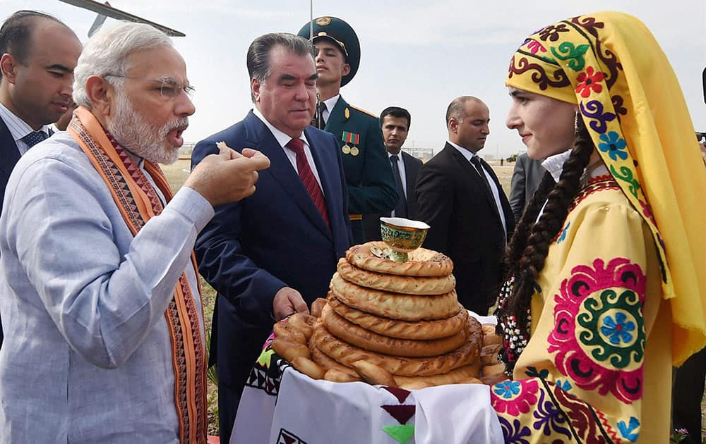 Prime Minister Narendra Modi gets a traditional welcome on his arrival for a visit to the India-Tajik Friendship Hospital (ITFH) in Quarghanteppa in Tajikistan.