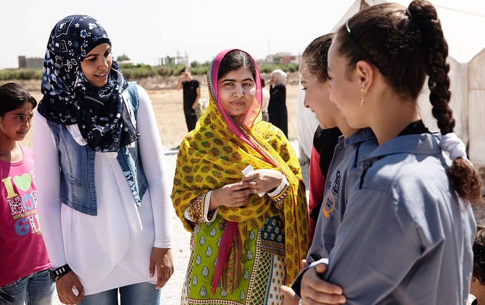 Nobel Peace Prize winner Malala Yousafzai, center, speaks with Syrian refugee girls during her visit to Bekaa Valley, east Lebanon. Malala celebrates her 18th birthday in Lebanon with Syrian refugees.