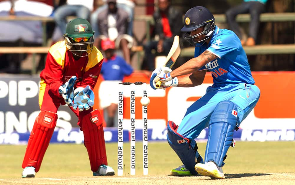 Manish Pandey plays a shot as Zimbabwean wicketkeeper prepares to catch the ball during the third One Day International cricket match against Zimbabwe in Harare, Zimbabwe.