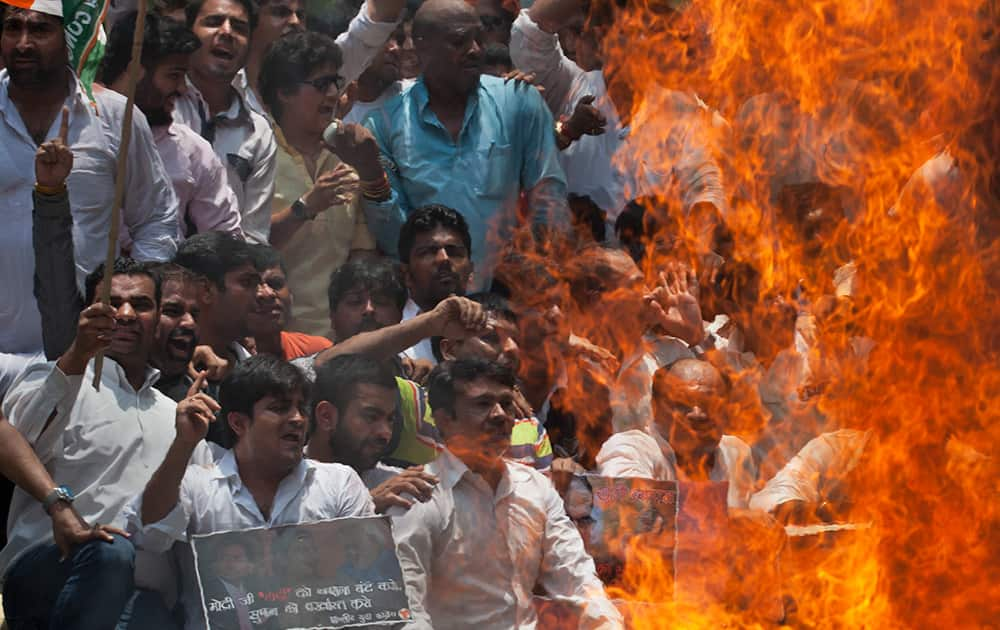 Activists of India's opposition Congress party's youth wing enact a mock Hindu funeral during a protest against a multimillion-dollar college admission and government job recruitment scandal in New Delhi.