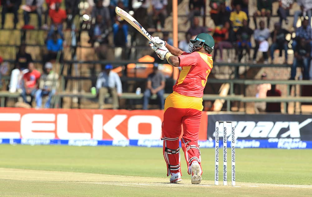 Zimbabwean batsman Hamilton Masakadza plays a shot during the third One Day International cricket match against India in Harare, Zimbabwe.