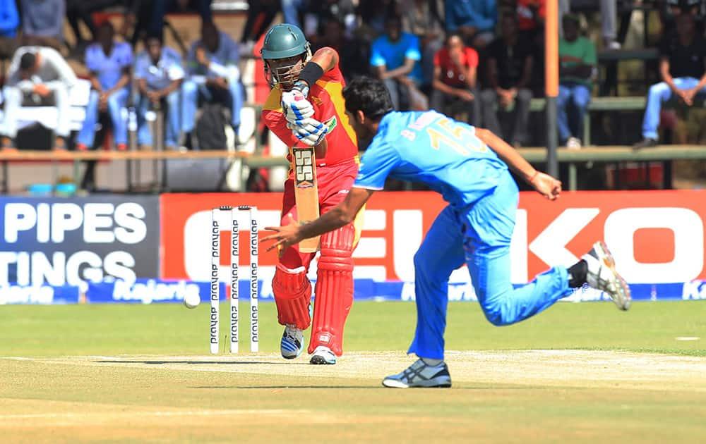 Chamunorwa Chibhabha plays a shot to Bhuveneshwar Kumar during the third One Day International cricket match against India in Harare, Zimbabwe.