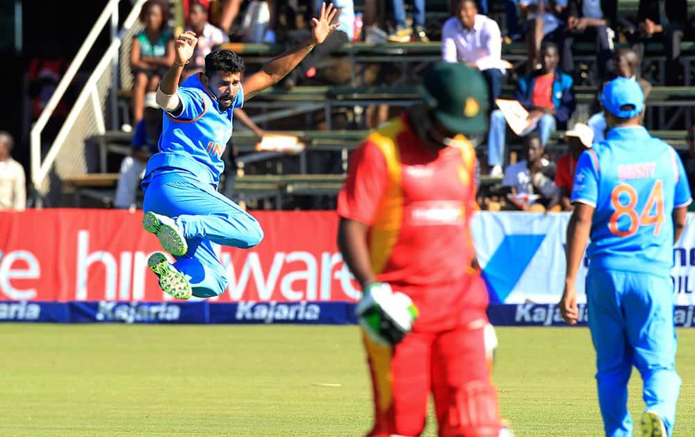 Murali Vijay celebrates the wicket of Zimbabwean batsman Regis Chakabva during their One Day International cricket match in Harare, Zimbabwe.