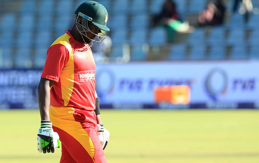 Zimbabwean captain Elon Chigumbura walks off the pitch after been dismissed during the One Day International cricket match against India in Harare, Zimbabwe.