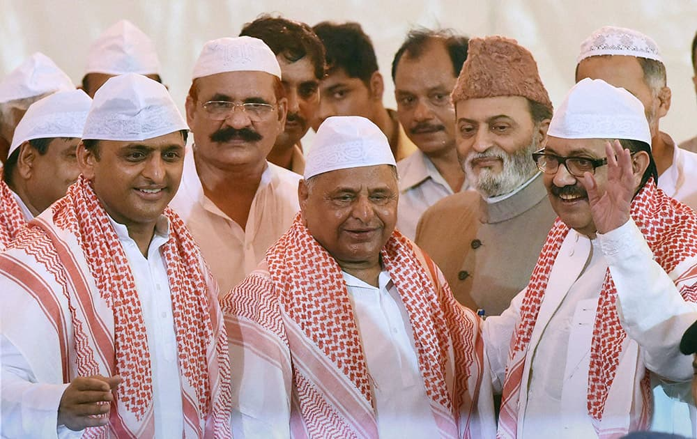 Uttar Pradesh Chief Minister Akhilesh Yadav, SP chief Mulayam Singh Yadav and Amar Singh at a Roza Iftaar party in Lucknow.