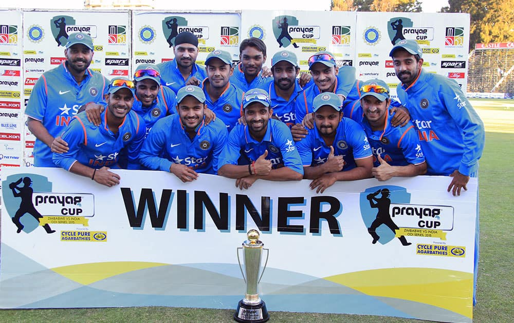 Indian cricketers pose with the trophy after they won the One Day International cricket match series against Zimbabwe in Harare, Zimbabwe.