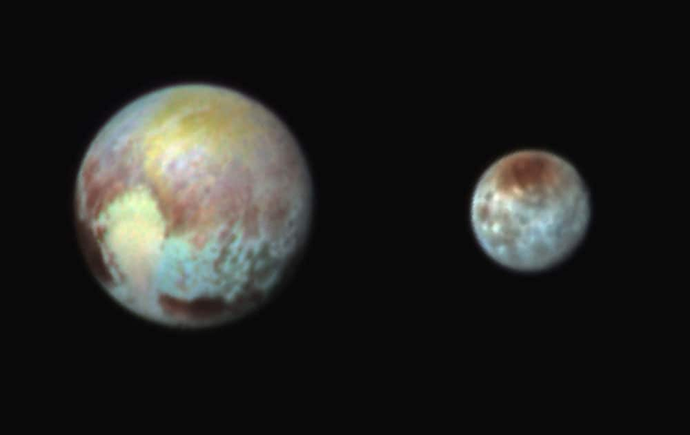 Pluto, left, and its moon, Charon, with differences in surface material and features depicted in exaggerated colors made by using different filters on a camera aboard the New Horizons spacecraft. In this composite false-color image, the apparent distance between the two bodies has also been reduced.