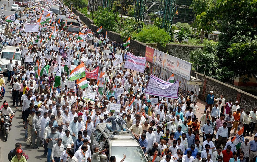 Congress and NCP members participate in a protest march of Mill workers from Ranibaugh to Azad Maidan, against BJP-Sena Government in Mumbai.