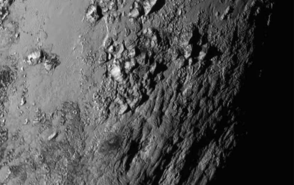 This image provided by NASA on Wednesday shows a region near Pluto's equator with a range of mountains captured by the New Horizons spacecraft.