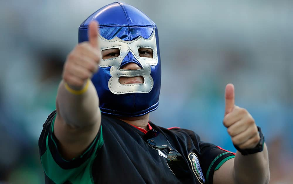 A Mexico fan cheers before a CONCACAF Gold Cup soccer match against Trinidad & Tobago in Charlotte, N.C.